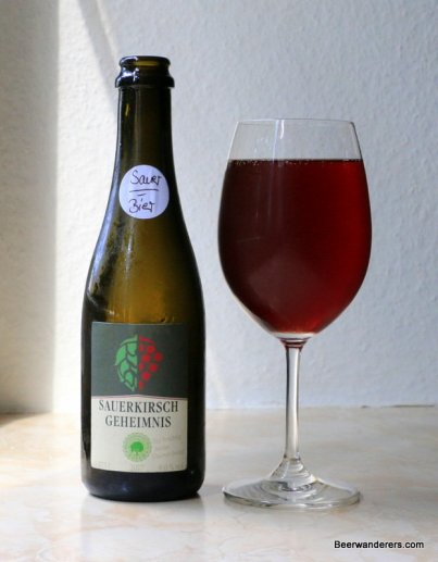 wine-like beer in wine glass with bottle