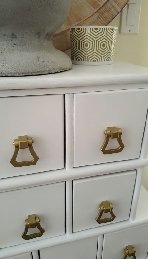 white apothecary makeover gold hardware