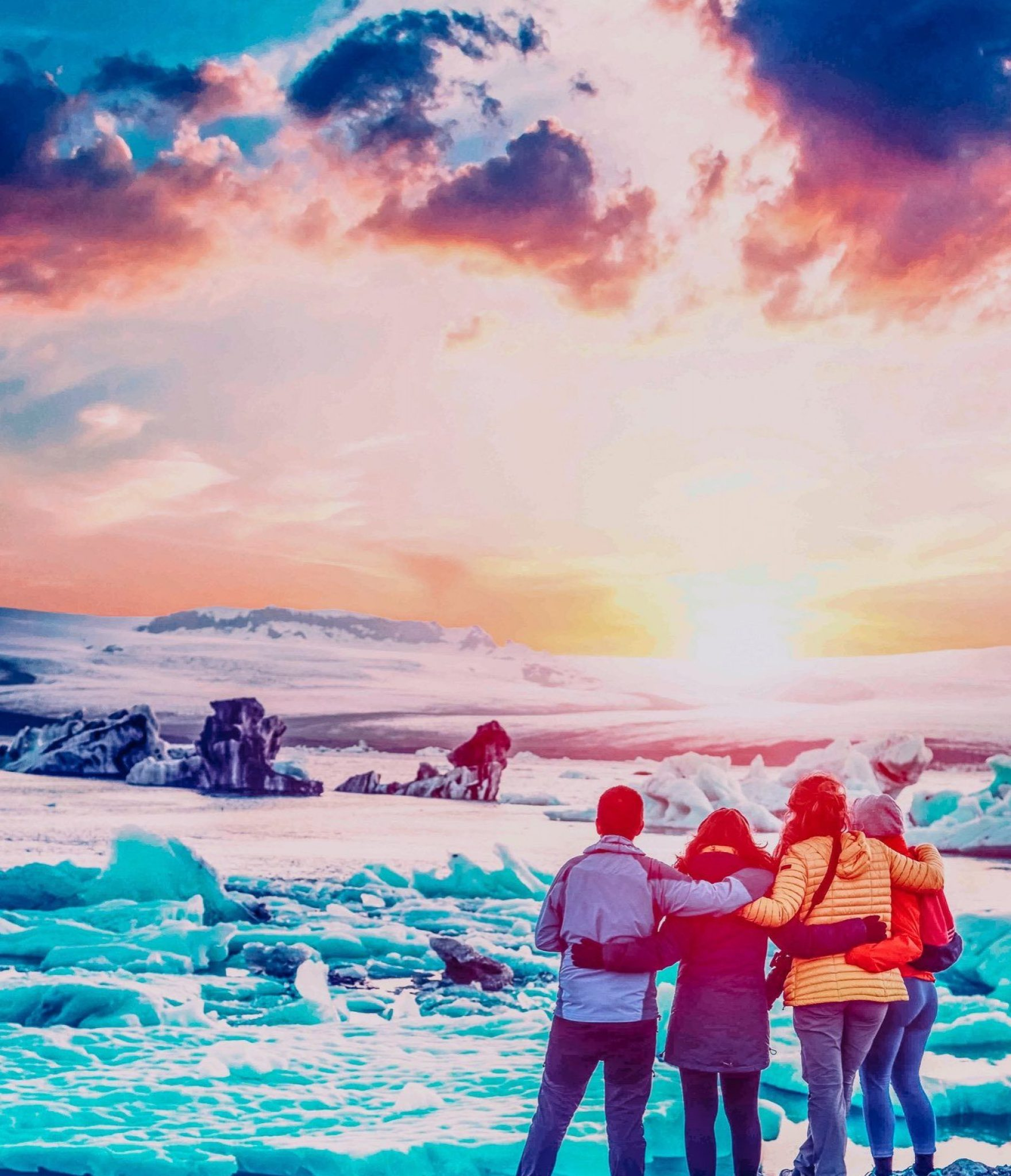 Four friends are looking at the sunset in the famous Jokulsarlon ice lagoon in Iceland. Exotic countries. Amazing places. (memories, impressions, rest, relaxation - concept)