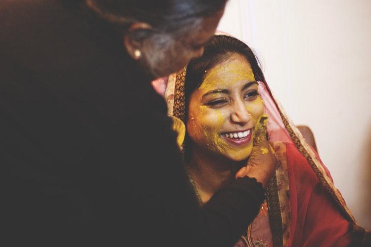 Turmeric mixture smeared on bride's face