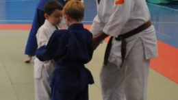 4 Simple Rules- Common Questions From New Judoka- Lt. j.g. Andy Barker, assists two young students in the proper way to grab an opponent