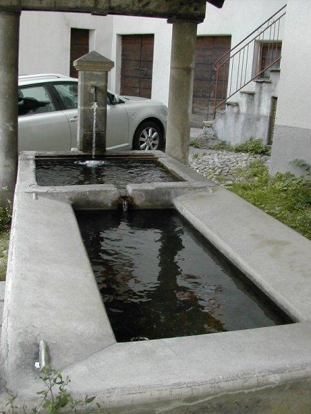 ancient stone laundry tub, Italian Alps