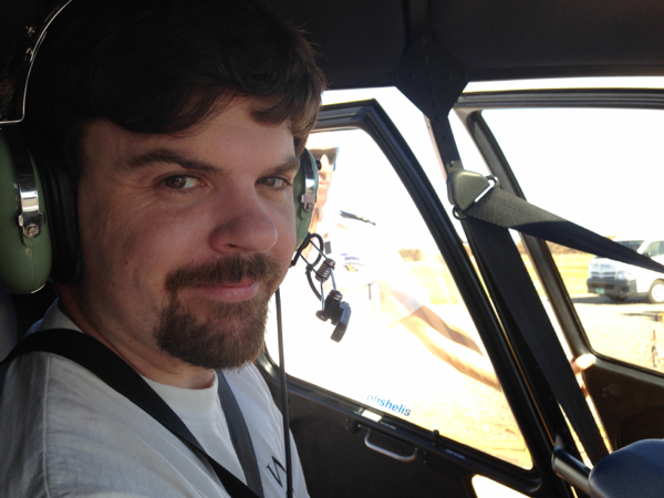 Brendan in a helicopter