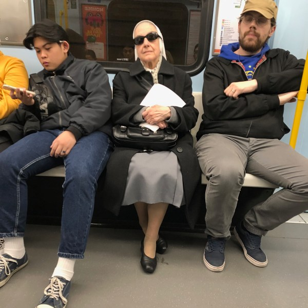 Cool nun on the Milan metro.