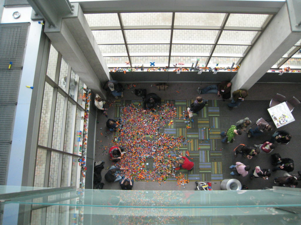 overhead view of people playing in the Lego pit, Austin Conference Center, SxSW 2009