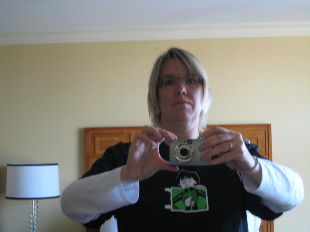 Deirdré in a hotel room, wearing the Joyent DTrace t-shirt