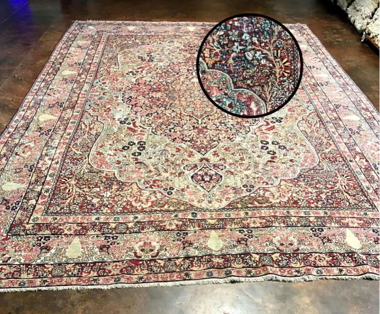 Antique rug with color bleeding