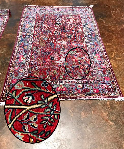 Zoomed in rug displaying white knot heads