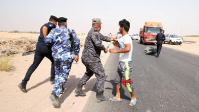 صورة قوات الأمن العراقية تطلق النار على المتظاهرين