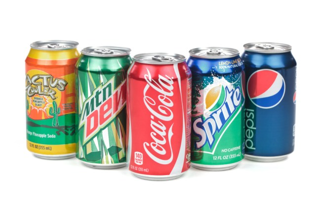 A bunch of soda cans on a white background