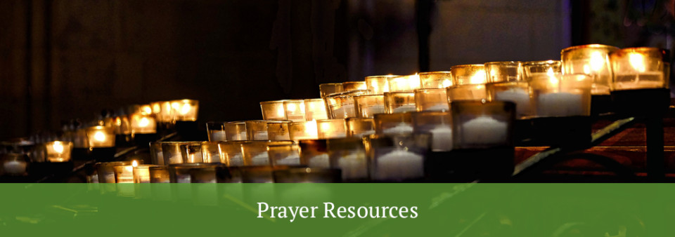 prayer resources - candles burning in a dark space