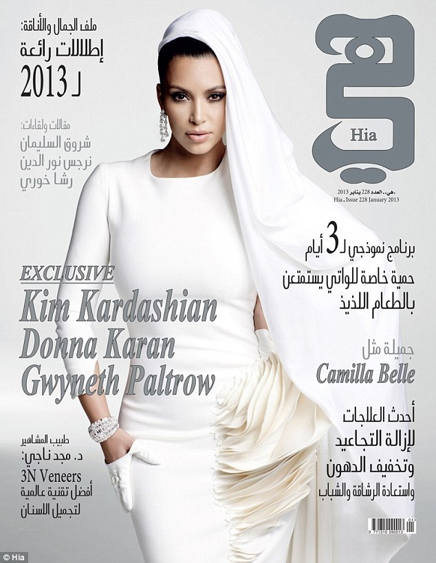Veiled Kim Kardashian is an Arabian cover girl… but reveals her breasts in daring gown