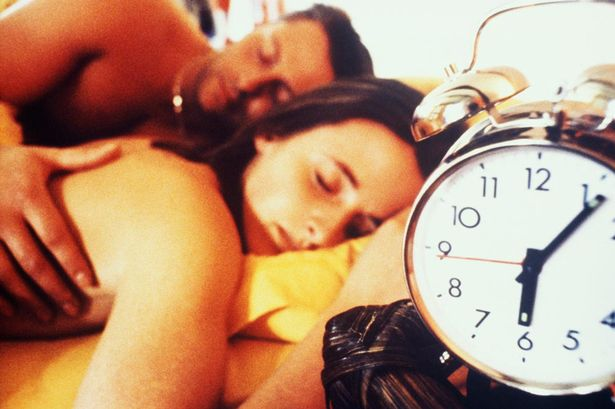 YOUNG+COUPLE+SLEEPING+WITH+ALARM+CLOCK