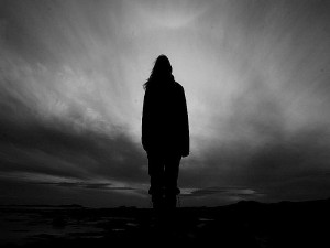 woman walking out of darkness