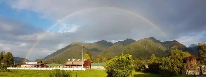 rainbow fox glacier new zealand sunset