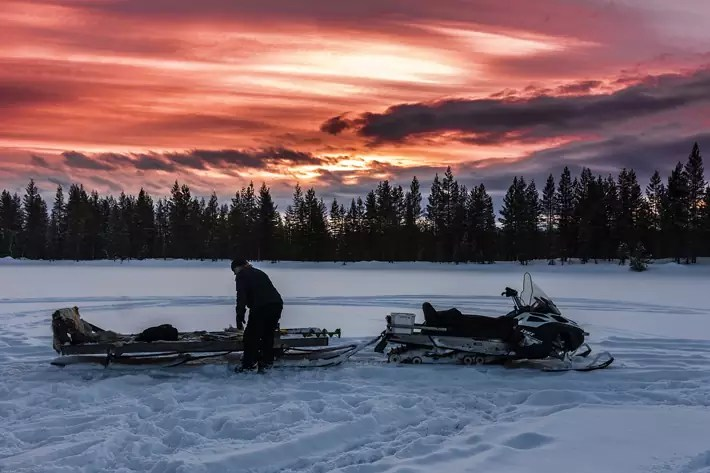 snowmobile-sunset,-Things-to-Do-in-Lapland,-where-is-lapland