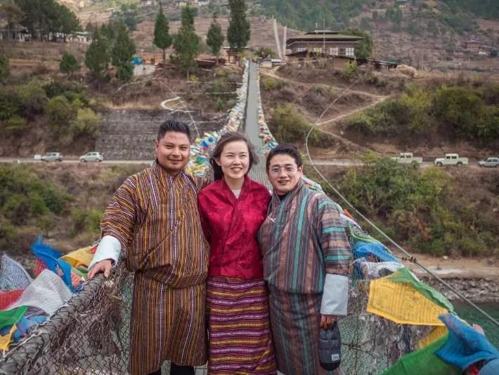 traditional costume, bridge, punakha, bhutan