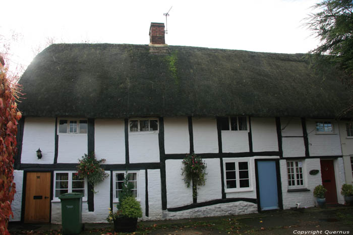 Row Of Houses In Timber Framing Under Thatched Roof