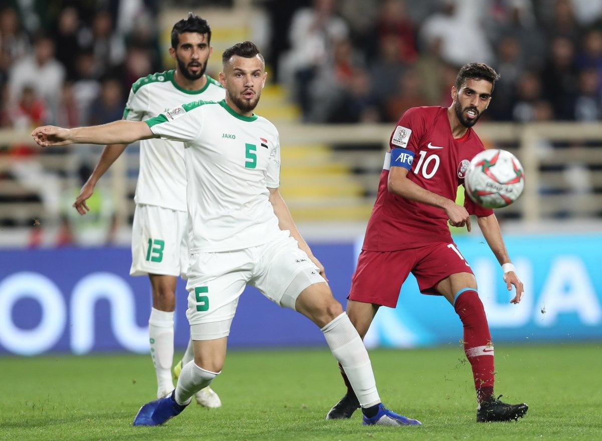 لقطة من مباراة قطر والعراق
