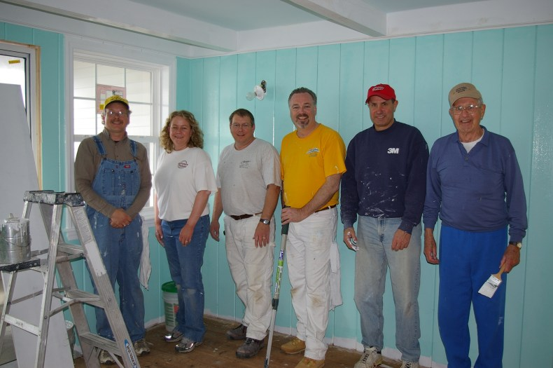 Believe In Tomorrow Corporate Partner The Dakes Company painting at the Children's House On The Bay