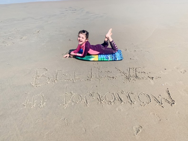A young girl enjoying her Believe In Tomorrow respite at the beach