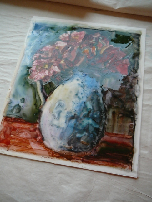 a wet painting of a vase of flowers on a sheet of drafting mylar