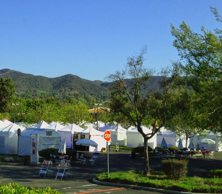 a row of artist's tents at an art festival in thousand oaks, california