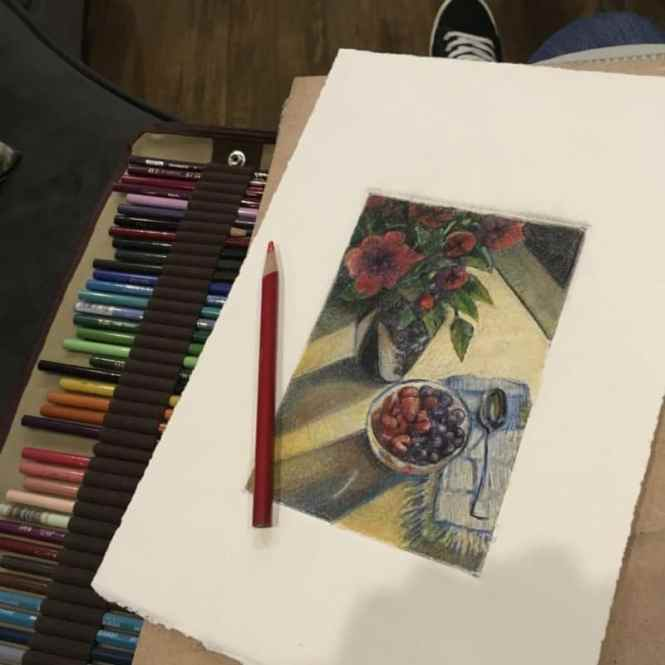 The same monochrome still life of roses and berries, now with color applied with pencils