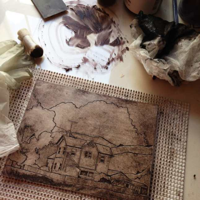 a mat board collagraph plate, with ink pushed into the incised linework