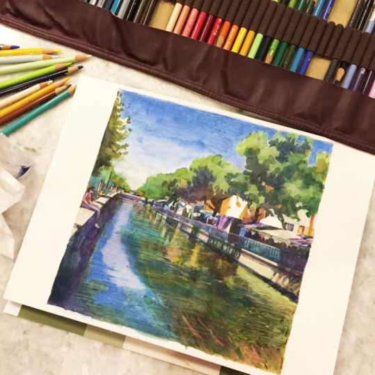 painting in watercolor with colored pencil