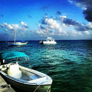boats on the caribbean sea in belize
