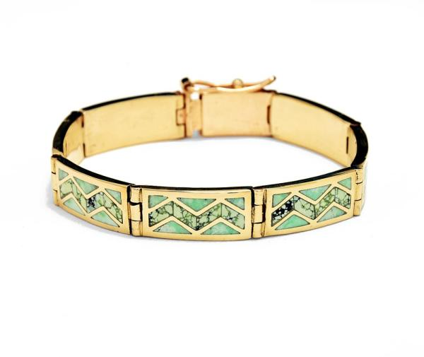 Gold bracelet with inlay stones