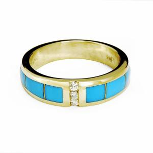 close up of gold and turquoise ring