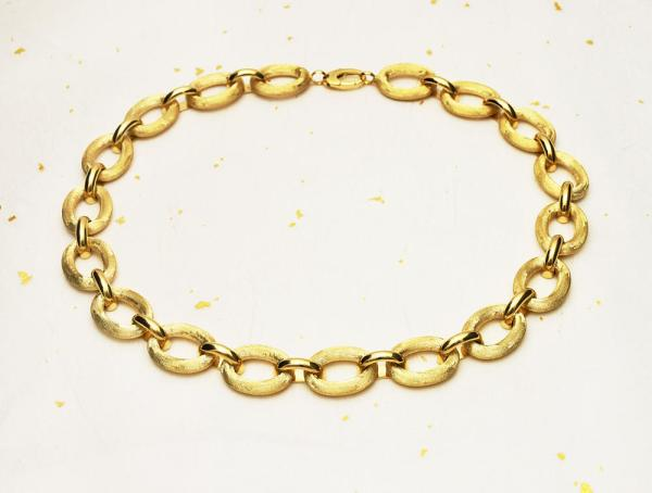 Gold necklace with over size links.