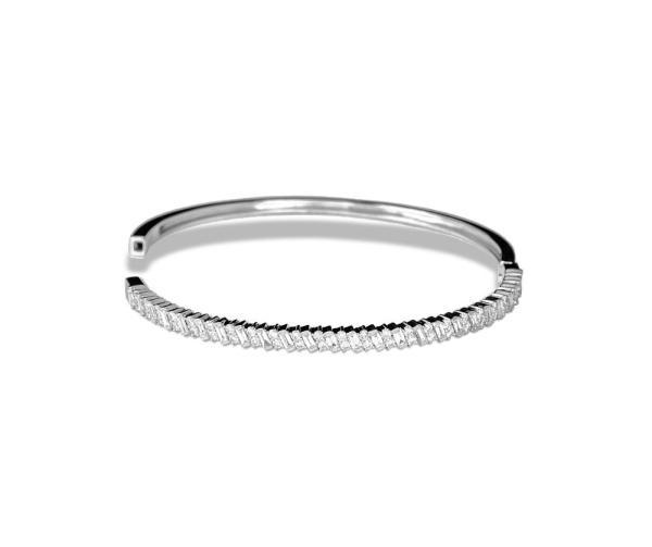 A thin bracelet with round and baguette diamonds
