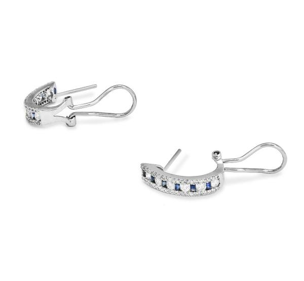 White gold earrings featuring daimonds and aquamarine stones