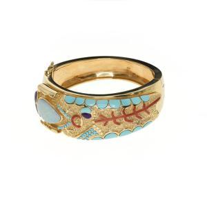 Gold bracelet with a corn maiden design