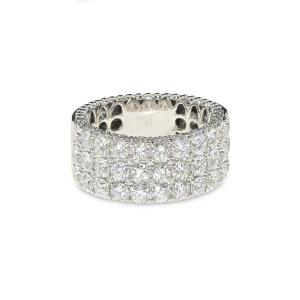 A wide white gold band covered with round diamonds