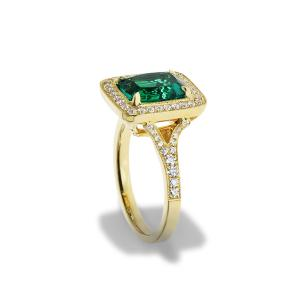 A yellow gold ring with a lrage emerald and diamonds