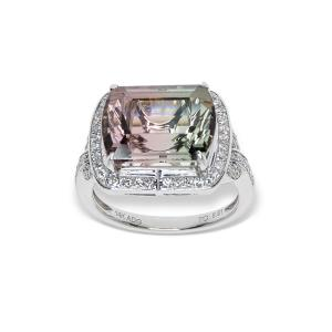 a white gold ring with a large tourmoline gemstone and diamonds