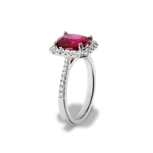 A white gold ring featuring a ruby gemstone and diamondsruby ring