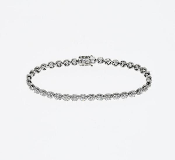 a white gold link style bracelet with over 500 diamonds