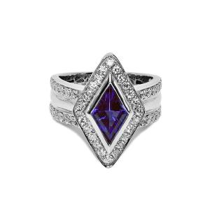 A white gold ring with a large tanzanite stone