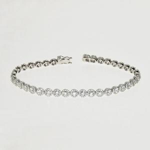 Gold link style bracelet with diamonds