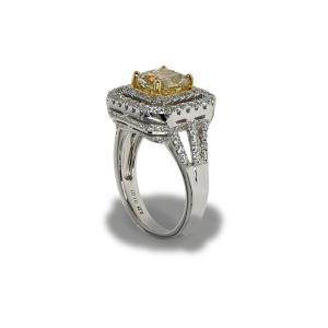 Gold ring with many small diamonds and a large center diamond