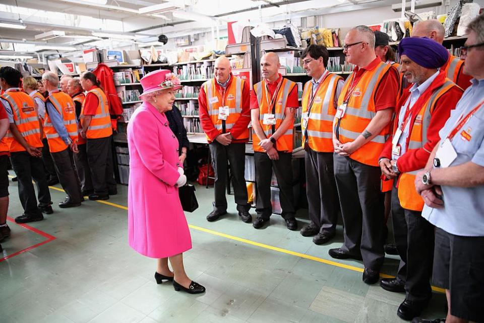 WINDSOR, ENGLAND - APRIL 20: Queen Elizabeth II meets postmen as she visits the Queen Elizabeth II delivery office in Windsor with Prince Philip, Duke of Edinburgh on April 20, 2016 in Windsor, England. The visit marks the 500th Anniversary of the Royal Mail delivery service. The Queen and Duke of Edinburgh are carrying out engagements in Windsor ahead of the Queen's 90th Birthday tommorow. (Photo by Chris Jackson - WPA Pool/Getty Images)