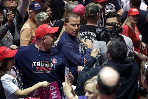 RENO, NV - NOVEMBER 05:  CNN's Noah Gray (R) is shoved and shouted at by supporters of Republican presidential nominee Donald Trump as he trys to cover breaking news during a campaign rally the Reno-Sparks Convention Center November 5, 2016 in Reno, Nevada. With less than a week before Election Day in the United States, Trump and his opponent, Democratic presidential nominee Hillary Clinton, are campaigning in key battleground states that each must win to take the White House.  (Photo by Chip Somodevilla/Getty Images)