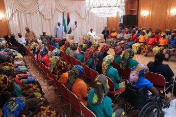 Image result for Chibok girls' release second anniversary gift to Nigerians - Buhari