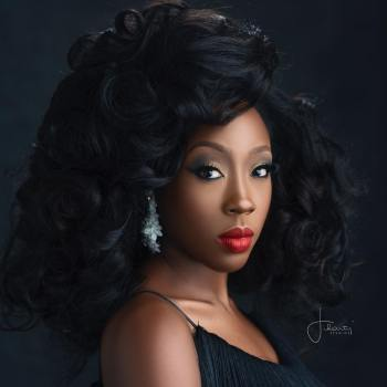 Beverly Naya Understands the Beauty of A Bold Red Pout