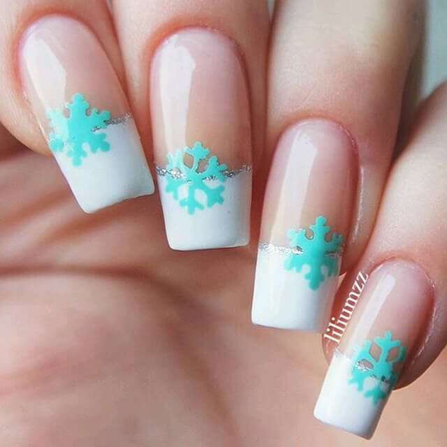 Clear Nail Polish Thick White Tips With Silver Stripe And A Mint Green Snowflake Decal